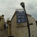 modern signs in ancient ruins